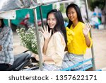 two young beautiful asian lady... | Shutterstock . vector #1357622171