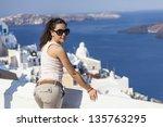 girl posing in santorini... | Shutterstock . vector #135763295