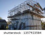 Scaffold With Temporary Roof...