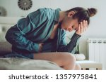 sad  unhappy woman suffering... | Shutterstock . vector #1357975841