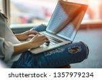 hand of woman traveller typing... | Shutterstock . vector #1357979234