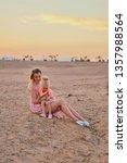 deserted beauty. girl  mother... | Shutterstock . vector #1357988564
