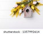 bird house spring flowers... | Shutterstock . vector #1357992614