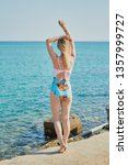 girl  model in a swimsuit on... | Shutterstock . vector #1357999727