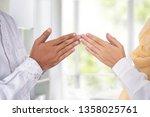 Small photo of close up gesture of hand finger tip touching. islam muslim greeting eid mubarak