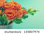 Bouquet Of Orange Roses In A...