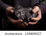 coal in the hands of the working | Shutterstock . vector #135809327