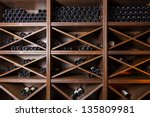wine cellar with bottles on...