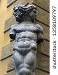 Small photo of Old two-faced Janus sculpture in Reggio Emilia, Italy