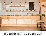 Stock photo interior of cafeteria with wooden bar counter shelves and board with drawn coffee cup 1358153297