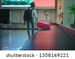 luggage reclaim at the airport... | Shutterstock . vector #1358169221