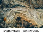 aerial view of an open mine pit.... | Shutterstock . vector #1358299007