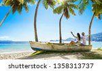 happy couple relaxing on the... | Shutterstock . vector #1358313737