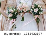 the bride holds a wedding... | Shutterstock . vector #1358433977