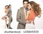 elegant couple posing | Shutterstock . vector #135845555