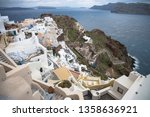 the picturesque village of oia  ...   Shutterstock . vector #1358636921