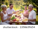 happy family having lunch in... | Shutterstock . vector #1358639654