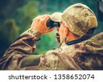 Caucasian Hunter Spotting Game Using Binoculars. Hunting Season. - stock photo