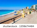 sunbeds with umbrellas at the... | Shutterstock . vector #1358674484