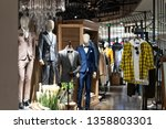business suit in shopping mall... | Shutterstock . vector #1358803301