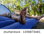 bare dirty male feet resting on ... | Shutterstock . vector #1358873681