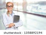 female doctor using her digital ... | Shutterstock . vector #1358892194