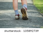 woman walking in the park ... | Shutterstock . vector #135892739