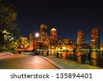 Stock photo boston harborwalk and cityscape at night 135894401