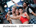 happy friends taking selfie at... | Shutterstock . vector #1358949977