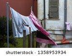 wind blowing laundry in san... | Shutterstock . vector #1358953934