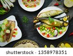 Stock photo mediterranean food smoked herring fish served with green onion lemon chili pepper lettuce 1358978351