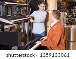 smiling boy and father deciding ... | Shutterstock . vector #1359133061