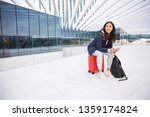 positive young woman in jacket... | Shutterstock . vector #1359174824