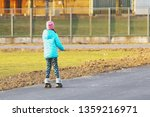the girl rides on rollers on a... | Shutterstock . vector #1359216971
