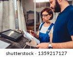 female cnc machine operator and ... | Shutterstock . vector #1359217127