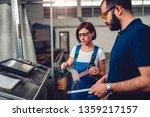 female supervisor measuring cut ... | Shutterstock . vector #1359217157