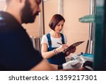 female stock clerk controlling... | Shutterstock . vector #1359217301