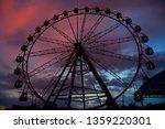 ferris wheel on dusk sky... | Shutterstock . vector #1359220301