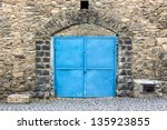 Stone Wall With Arch And Blue...