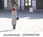 a woman in a stylish autumn... | Shutterstock . vector #1359443744