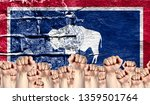 male hands clenched in a fist... | Shutterstock . vector #1359501764