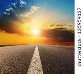 Asphalt Road Under Sunset With...