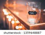 Tips Jar On A Bar Countertop....