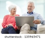 senior couple with laptop... | Shutterstock . vector #135965471
