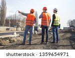 male workers engineers at a... | Shutterstock . vector #1359654971