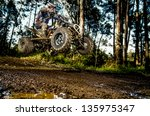 quad rider jumping on a muddy... | Shutterstock . vector #135975347