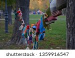 hats hanging on a tree | Shutterstock . vector #1359916547