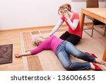 blond young woman makes an... | Shutterstock . vector #136006655