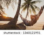 tourist relaxing in hammock on... | Shutterstock . vector #1360121951