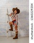 little girl in a wide brimmed... | Shutterstock . vector #1360229204